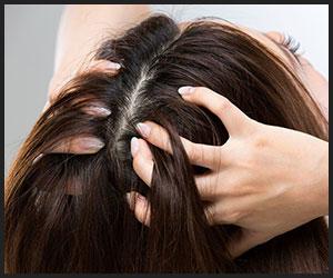 a girl is massaging her hair