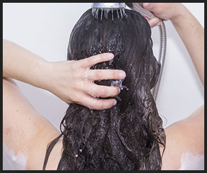 A girl is washing her hair
